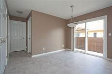 dining area painted mocha brown with white trim