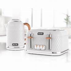 curve jug kettle and toaster set white and gold