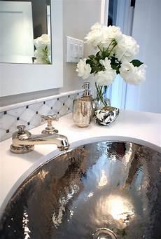 tamara mack design bathroom with gray paint color hammered metal sink marble tiles backsplash