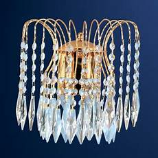 waterfall wall light in gold with crystal droplets searchlight 5172 2