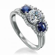 what to know about 3 stone diamond engagement rings and