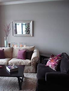 purple and gray living room decor the gray walls purple pillow combo but for our