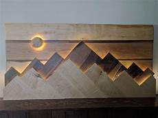 wood mountain range wall art the sun moon functions as a dimmer switch for the lights behind