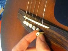 how to replace guitar strings how to change a string on an acoustic guitar