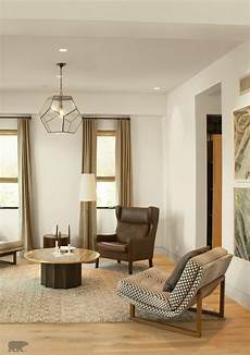 coat the walls of your living room with a neutral tone of behr paint in spun wool this
