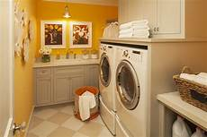 sunny yellow in laundry room that has no windows fun art work and great storage martha o hara