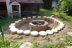 errichtung einer feuerstelle mit baumst 252 mpfen