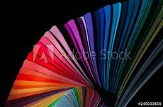 color fan deck with sles of various paint isolated a black background buy this stock