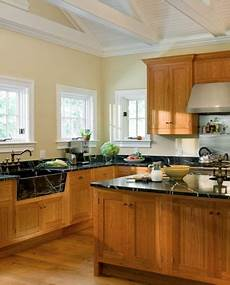 how to pick the right paint color to go with your honey oak trim and cabinets yellow kitchen