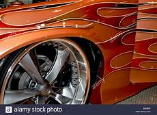 custom muscle car with allow rims showing flame paint job royalty free image