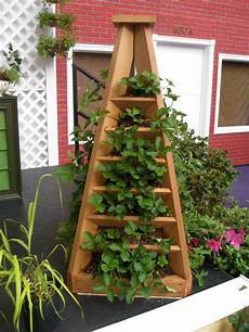 container garden tower pyramid how to build it vibrant vertical garden pyramid planter guide and