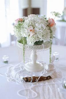 vintage inspired rose and hydrangea centerpiece with pearls