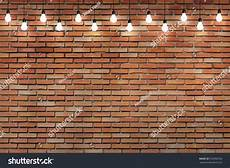 light bulb brick wall brick wall bulb lights l 552960556