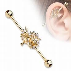 piercing industriel bijoux piercing industriel acier or avec un arbre de vie xyx