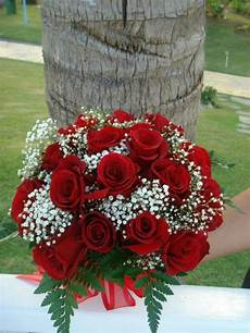 lovely wedding bouquet of classic red roses white baby s