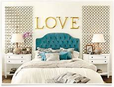 blue velvet headboard white bedding gold accents in this