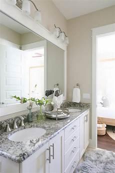 wall color sw alabaster cabinets are sw dover white the granite is cambridge white granite