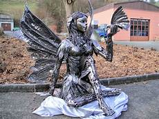 amazing metal sculptures made from reclaimed bronze simply creative recycled car parts sculptures by tom samui