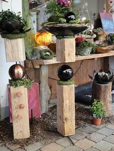 Holzbalken Deko Garten - alte holzbalken mit schwarzen und kupfernen