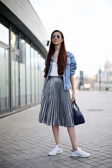 picture of a white top a grey pleated midi skirt a blue