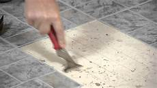 how to remove vinyl tiles adhesive from wood flooring