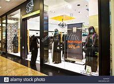 Woman entering shop selling traditional Muslim women's