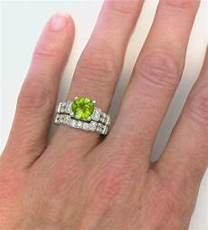 peridot engagement ring in 14k white gold with matching band options gr 3054
