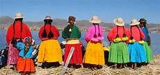 bolivian in brightly colour traditional clothing uros island lake titicaca south