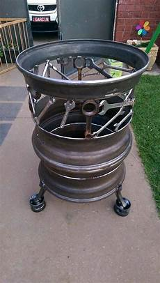 Pit Made From Tire Rims And Discarded Tools By
