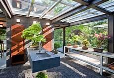 a glass house in the garden contemporist