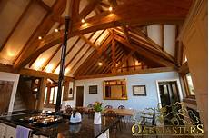 Spot Lighting Showcases Open Ceiling With Exposed Rafters