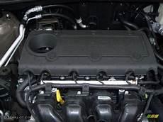 online service manuals 2011 kia sportage electronic valve timing 2011 kia sportage ex awd 2 4 liter dohc 16 valve cvvt 4 cylinder engine photo 47570855