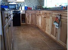 Hickory cabinets, tile floors, quartz countertops. What a