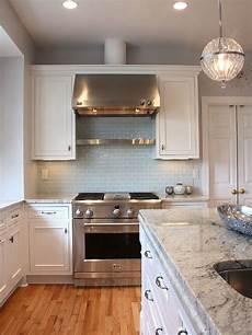 light blue subway tile backsplash classic white kitchen