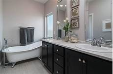 master bath with cast iron footed tub espresso cabinets