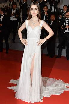 lily collins glimmered in a sheer dress that looks like it s made from moonlight