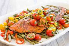 one pan roasted harissa salmon with vegetables recipe simplyrecipes com