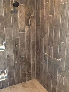 tile ideas for bathroom walls try wood look tile on your shower walls in a random pattern it goes with a country style or
