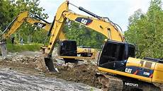 excavator digging new road construction equipment work cat 320d youtube