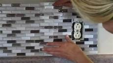 Kitchen Backsplash Around Outlets by How To Cut Peel And Stick Smart Tiles Around An Electrical