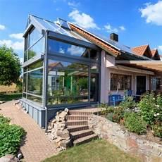 einfamilienhaus zweistoeckiger wintergarten mit zweigeschossig baumann wintergarten