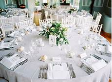 round table set with menus and floral centerpiece for