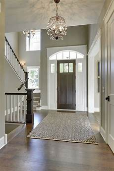 gorgeous entryway with high ceilings tall front door