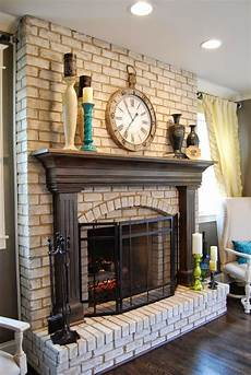 brick fireplace with white mantel repainted for a cozy feel love eating in front of the