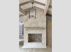 Austin stone fireplace to ceiling     Stacked stone