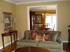 sw restrained gold paint color for living room would go with our olive green blue