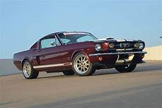 a street track 1966 ford mustang fastback with a coyote