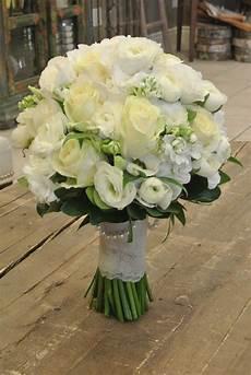 bridal bouquet with roses ranunculus lisianthus stocks