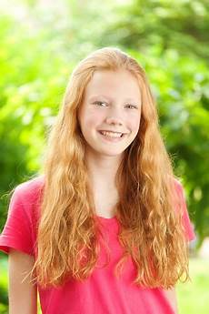 young girl with red hair stock photo image of forest portrait of caucasian teenage girl with red hair stock photo download image now istock