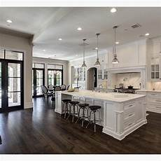The Contrast Of White And Wood Floors By
